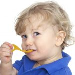 Boy-with-yellow-I-can-spoon[1]